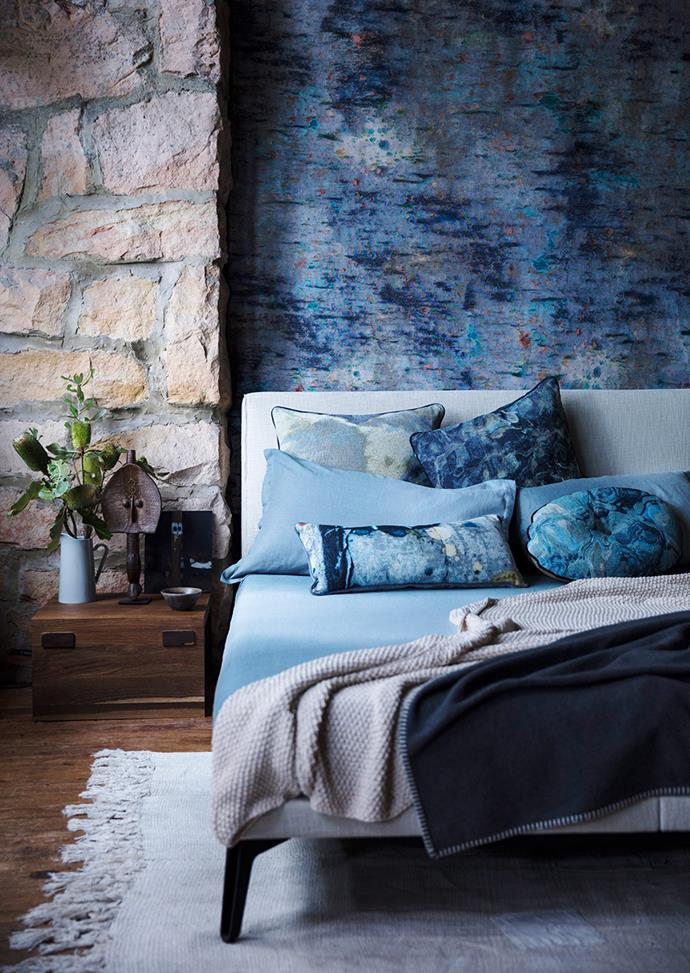 Moodier colours such as navy promote rest and sleep. Soften the drama of the dark space by adding in natural textures, greenery and accents in lighter tones. *Photo: Jem Cresswell/bauersyndication.com.au*