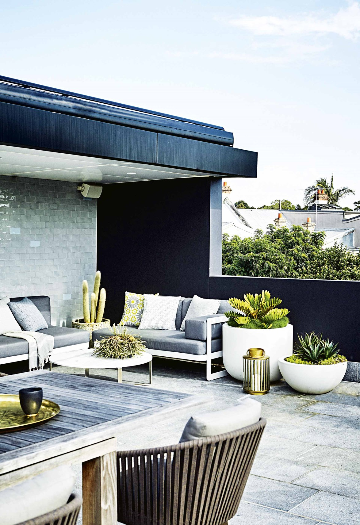 "Modern planting and sharp lines give this rooftop terrace and garden by Adam Robinson a contemporary appeal. ""The aim was to complement the architecture but also to soften it a bit and ground it in the property,"" says Adam."