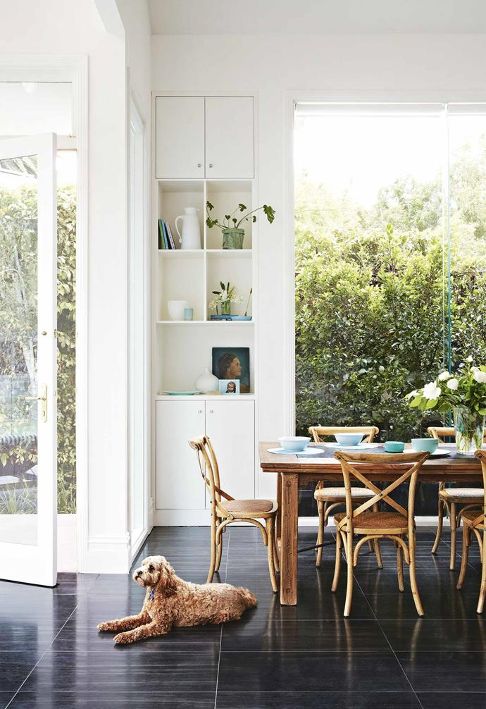 "**Dining area** Murphy the cavoodle is quite at home on the black-tiled floor that mirrors the rich floorboards in the remainder of the home. The dining setting is made up of an old pastry table with chairs from Coco Republic. Uashmama bag, arrow and placemats, [Shelley Panton](https://shop.shelleypanton.com/|target=""_blank""