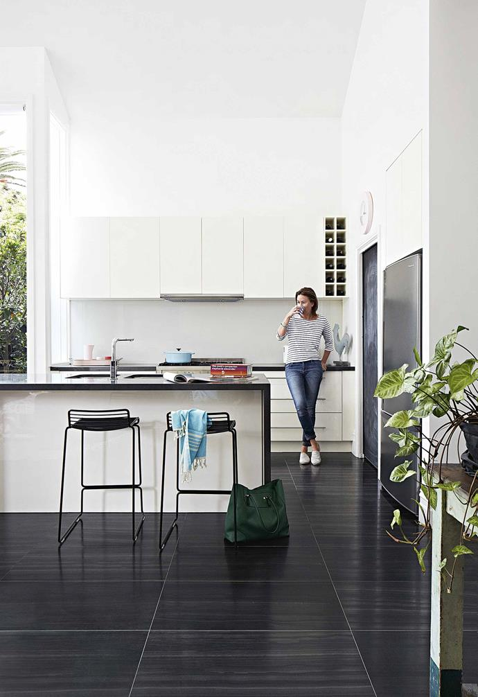 "**Kitchen** While it's not Emma's dream kitchen, the practical space works well for the family. ""I would have a big ceramic sink and a concrete benchtop,"" says Emma. Blue towel, [Shelley Panton](https://shop.shelleypanton.com/