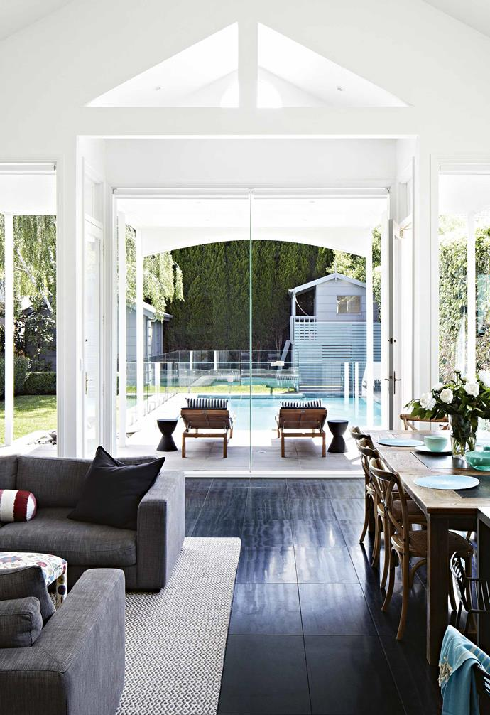 "**Family room** This generous space perfectly marries the indoors with the outdoors. Though it includes living, dining and cooking zones, the high ceiling and uncluttered styling add to the room's open feel. The outdoor area offers a range of play stations for Poppy and Lulu, with the [swimming pool](https://www.homestolove.com.au/swimming-pool-installation-18898|target=""_blank""), grassy spot and cubby house, too."