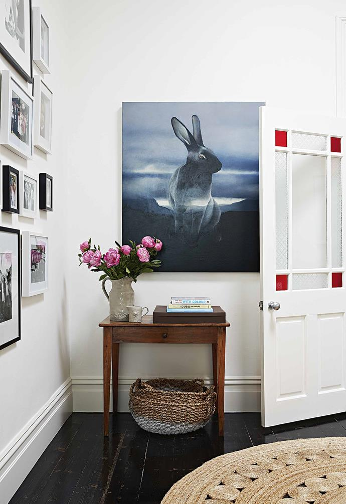 **Hallway** Running by Amanda Parer brings a moody feel to the home's crisp white shell.