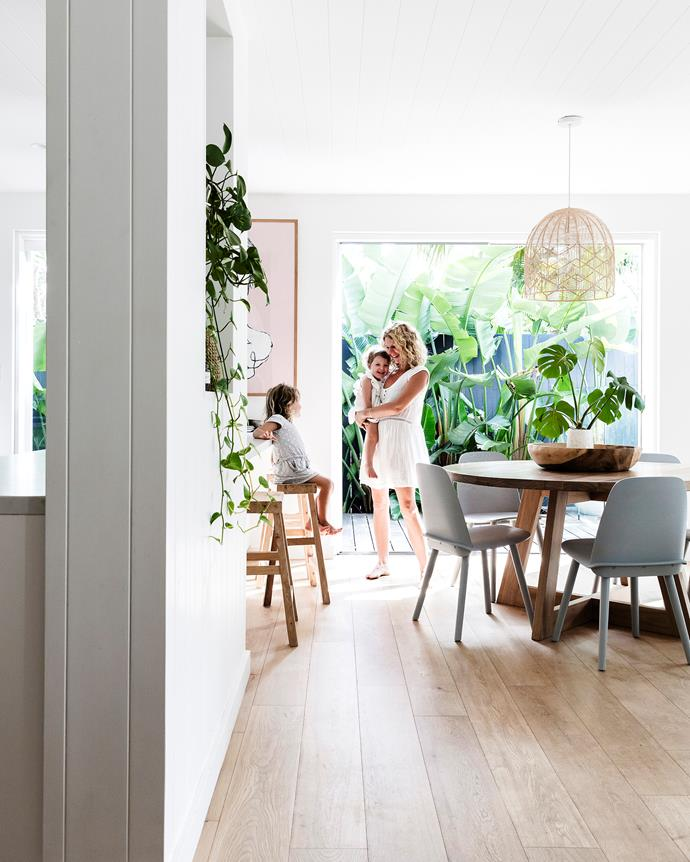 """I prefer uncluttered, open spaces and absolutely love the raw, natural timber look,"" says homeowner Sally. Here, she's paired a Hendrix & Harlow dining table with Muuto dining chairs and a rattan pendant light from Milly & Eugene."