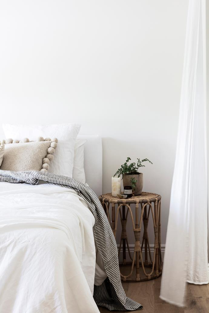 """It's a lovely, calm space,"" says Sally of the master bedroom. A Joe linen bedhead from MCM House is paired with floaty, custom-made linen curtains. The bedlinen is from I Love Linen."
