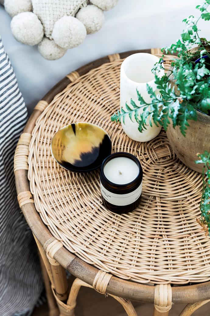 A rattan table from Nikau Store is the perfect spot to display bedside curios and a cute candle from Posie.