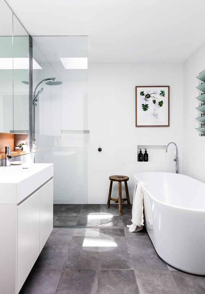 The main bathroom, used mostly by the kids, features a Posh Solus freestanding bath from Reece plus a few natural elements to help soften the overall look. The print is by Kimmy Hogan from Greenhouse Interiors.