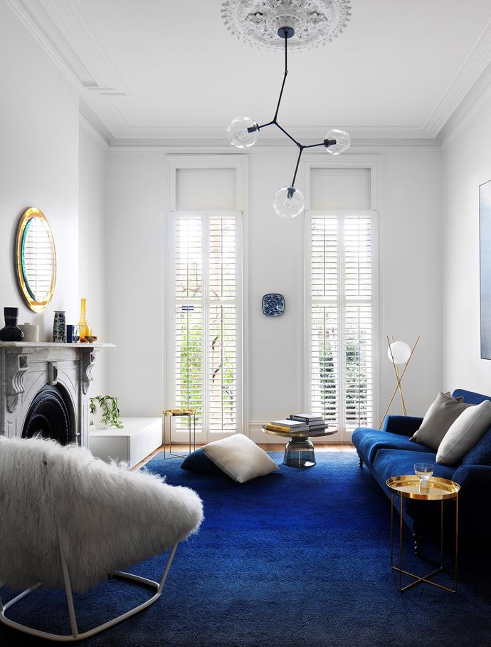 Bold colour and contemporary features up the ante in this Victorian terrace and anchor it firmly in a new era courtesy of architect David Luck and Hecker Guthrie. Custom rug from Whitecliffe Imports and an SCP 'Oscar' sofa from Hub. E15 'Habibi' side table in polished brass. ClassiCon 'Bell' coffee table from Anibou. Michael Anastassiades 'Tree in the Moonlight' brass standing lamp from Euroluce. *Photograph*: Shannon McGrath. From *Belle* November 2016.