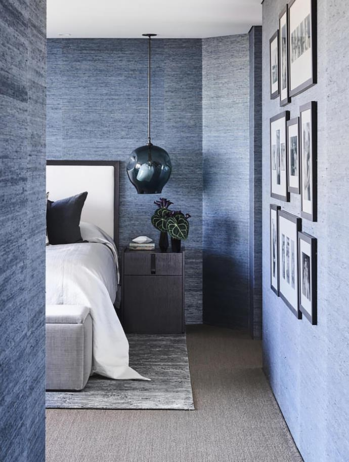 In the master bedroom, Phillip Jeffries wallpaper, Lindsey Adelman pendant light, bedside table from Featherwood Furniture and rug from Designer Rugs.