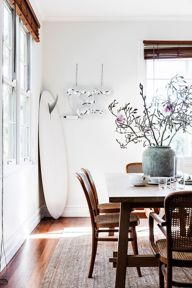 Style tip: Put your passions on display. Prop a surfboard in an empty corner, stack cookbooks on your coffee table or hang handbags over door handles.