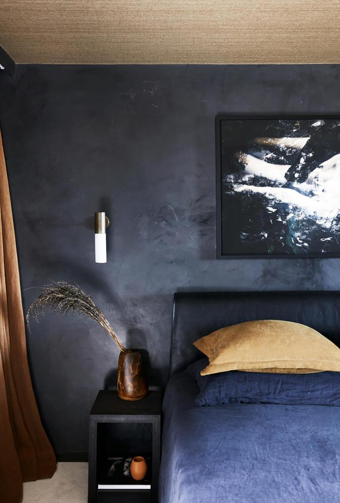 Januz Wozny Dream artwork from Black Eye Gallery and Etoile aged brass wall light from Light Co. Cassina 'Cab' bed from Cult with Jardan bedlinen. Custom bedside table by Amber Road made by Forest Furniture.