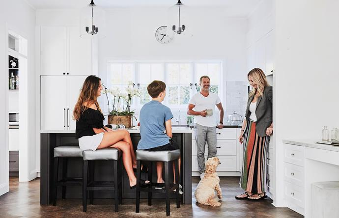 Chynna, Jovi, Sean and Julia Laaman with Bailey, their pet spoodle. Carrara marble features on the kitchen benchtops; the splashback tiles are from Amber Tiles. Shaker-style polyurethane cupboards in Dulux Vivid White and island base in Monument.