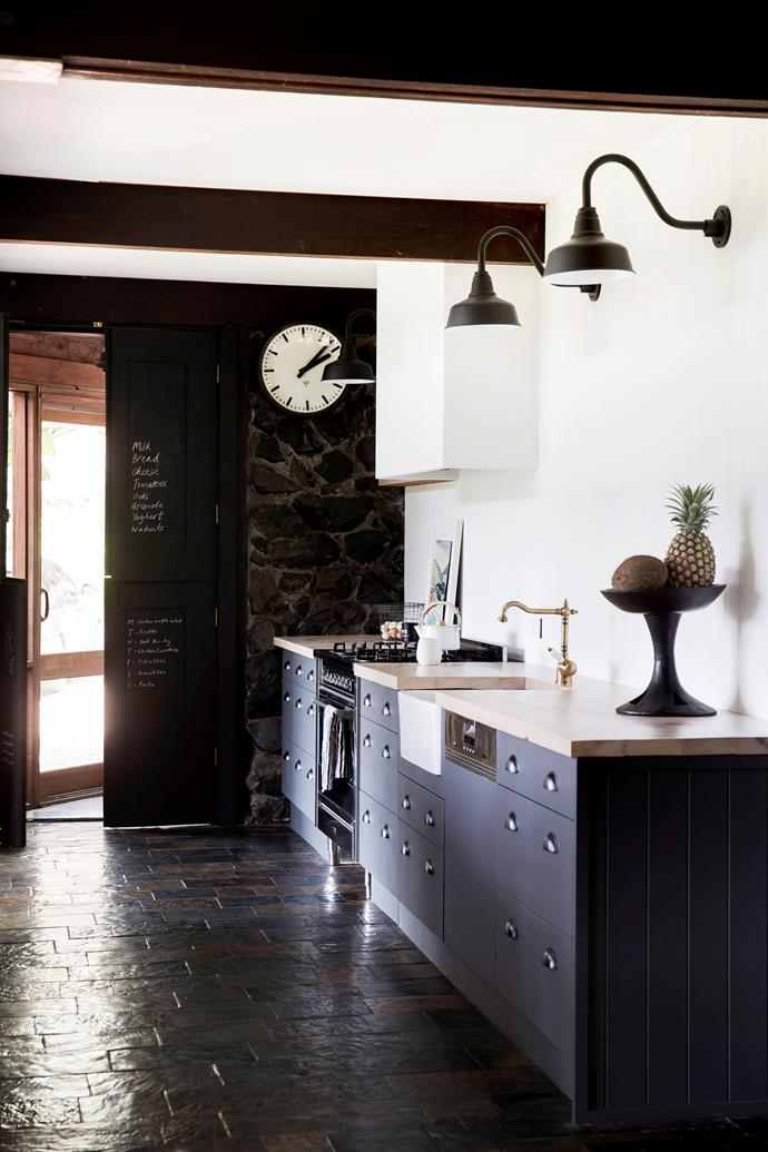 "**Modern Provincial** For those with a penchant for [French provincial design](https://www.homestolove.com.au/french-provincial-kitchens-6332|target=""_blank""), this contemporary kitchen is a study in how to combine the best of both. Curved ornate fittings, such as the wall lamps and decorative brass sink mixer, add charm to the cabinets' clean, minimalist lines. A pantry door becomes a clever calendar or grocery list with a coat of chalkboard paint. *Photo:* Chris Warnes"