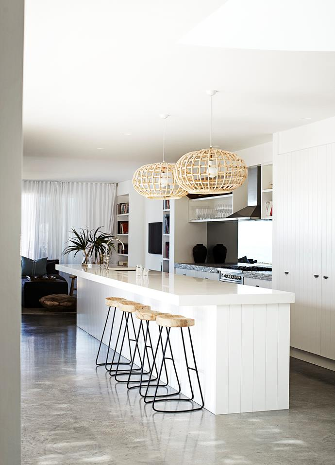 **Contemporary coastal** Cane pendants add a coastal touch to this modern kitchen. Lighting often plays best supporting act, but these pendants take a leading role. A simple way to turn pendant lights into a statement feature is to place them in a row over the space you want to illuminate and choose a patterned or woven design which will cast a beautiful, diffused glow. *Photo:* Sharyn Cairns