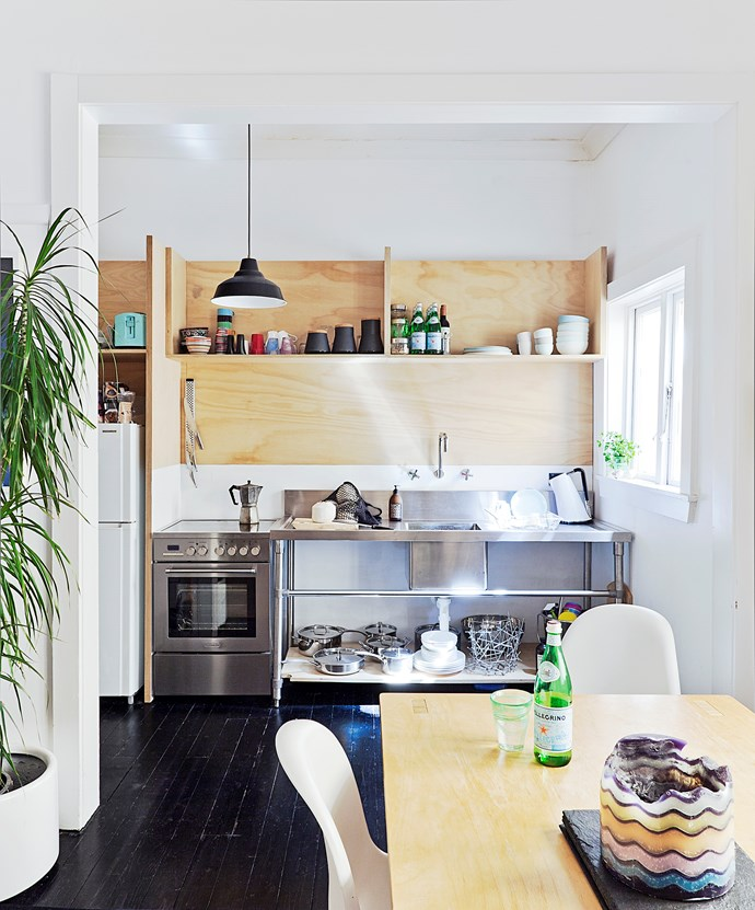 **Cheap and cheerful** This low-budget kitchen reno is packed with loads of character. The light plywood storage creates a laidback vibe and the no-fuss commercial stainless steel sink is a practical addition. With all that open shelving, painting your walls white will minimise visual clutter. *Photo:* Felix Forest