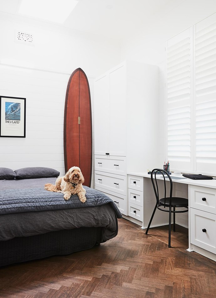 Surfing is a passion for Jovi and Sean. The poster of a famous surf break was a gift. Bed linen from Bed Bath N' Table. Quilt, Sheridan. Chair, Temple & Webster.