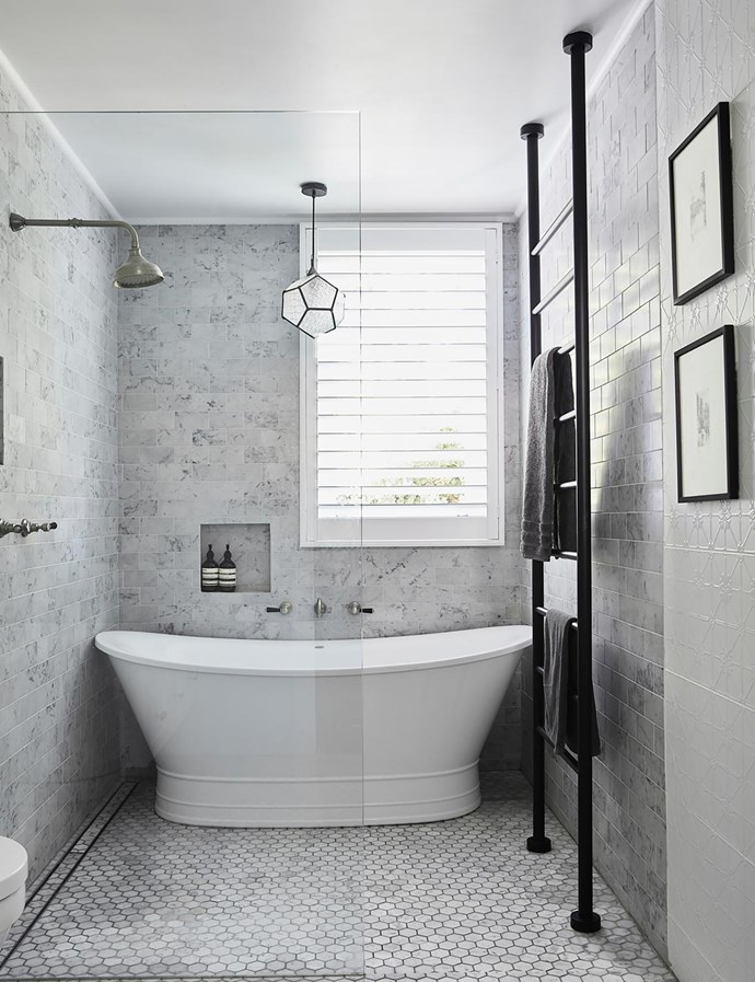 Doubling as the powder room, this space has a walk-in shower next to the Forme bath. Victoria & Albert basin and towel ladder, Just Bathroomware. Carrara marble vanity. Floor tiles and 'Infinity Richmond' ceramic wall tiles (at right), Amber Tiles. Taps, Brodware. Pendant light, bought in Bali
