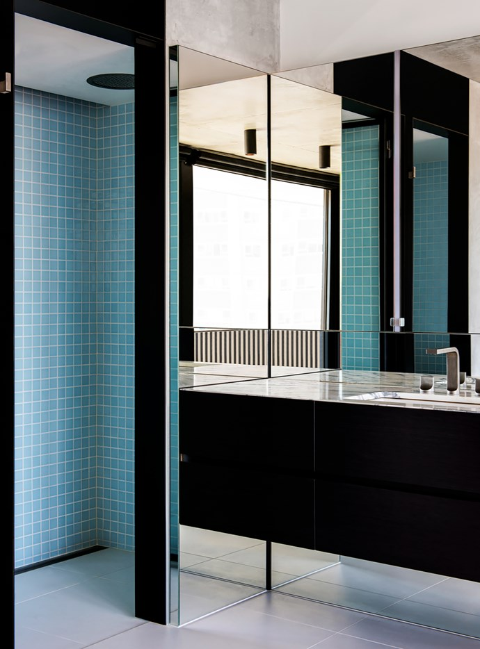 A monochromatic palette, bespoke cabinetry, sharp detailing and luxury fixtures and finishes give this unique bathroom designed by Leo Terrando and Kristen Sutton of SJB a distinctly urban identity. *Photograph*: Nicole England. From *Belle* April 2017.