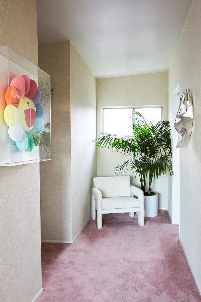"Pink carpet is a playful feature in the bedroom. ""I felt like using a tropical colour – we're in LA after all!"" Caroline says. The silver foil wall sculpture is from Mid Century Swag."