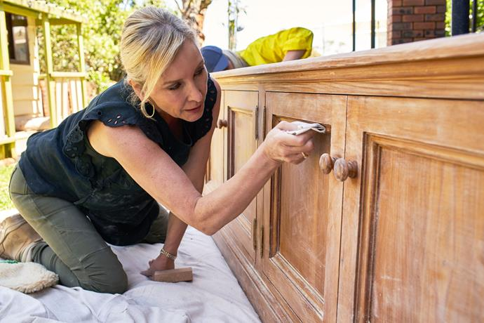 *Changing Rooms* is set to take a more hands-on approach to renovating that will empower viewers to makeover their own homes. Here, interior designer and stylist Jane Thomson, sands a cabinet in preparation for a room reveal.