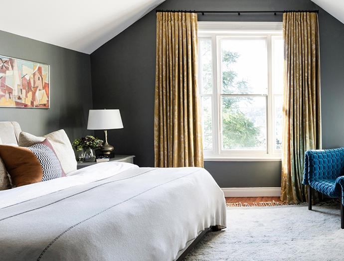 This master bedroom is instantly transformed into a luxurious hotel suite by the statement gold curtains that beautifully frame the simple rectangular window. *Image: Maree Homer / bauersyndication.com.au*