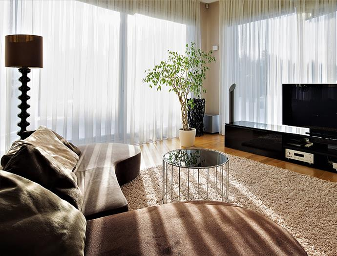 "The furnishings of this Art Deco inspired lounge room are made complete with the addition of [Victory Blinds' sheer curtains](https://www.victoryblinds.com.au/indoor/curtains/sheer-curtains|target=""_blank""