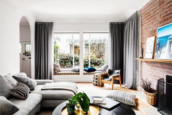 This bay window adds character to this living room, also making the perfect sun-filled reading nook. *Image: Amelia Stanwix / bauersyndication.com.au*