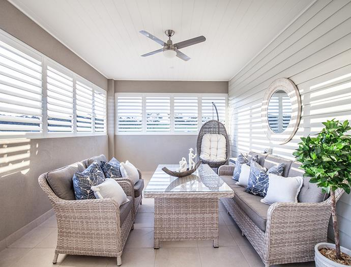 These plantation shutters from Victory Blinds allow afternoon light to stream into this sunroom. *Image: supplied*