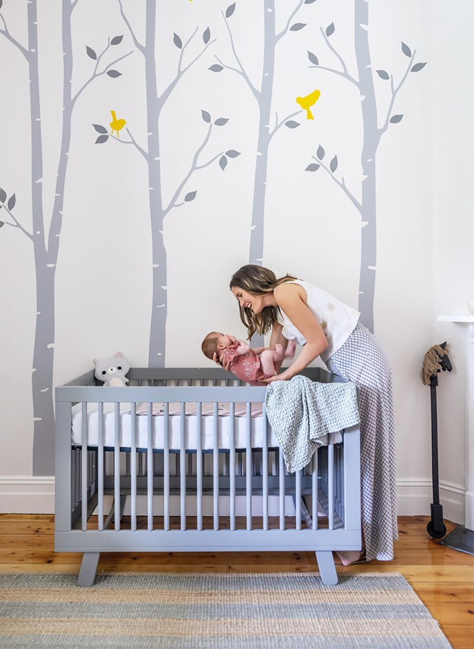 """Custom decal through Etsy. """"I chose the colours once the cot arrived,"""" Sally explains. Babyletto 'Hudson' 3-in-1 cot from Nordstrom (US). Cot linen and throw, Eccola. Indus Design 'Lola llama' baby blanket and 'Betty Cat' toy, Flourish Gift and Home. Armadillo & Co rug, Terrace Floors + Furnishings."""