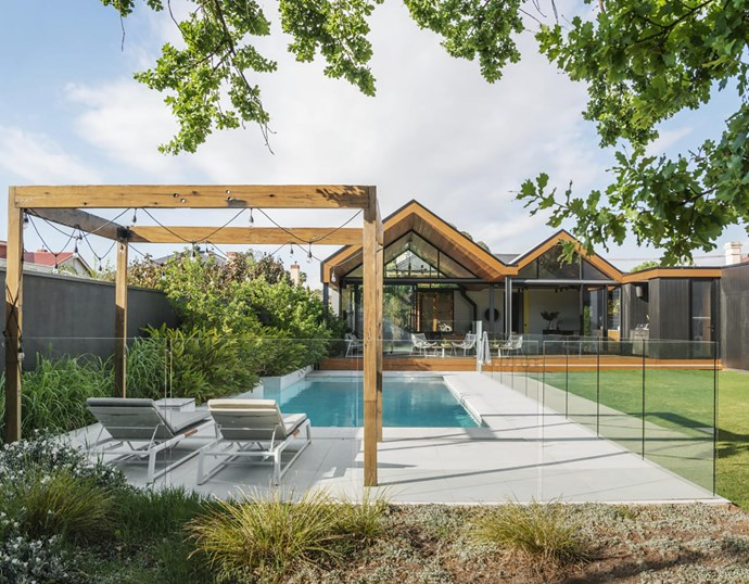 """""""Slightly elevating the deck has allowed us to see over the pool,"""" says Sally. Blackbutt decking, Boral. Integrated Beefeater barbecue. Outdoor furniture, GlobeWest. Cladding is CarterHoltHarvey 'Shadowclad' painted black. Pergola in reclaimed turpentine from a bridge in Coonabarabran."""