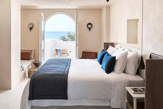 """**Greek getaway** <br><br> Istoria Hotel is a 12-suite retreat on the island of Santorini. With views of the Aegean Sea and volcanic-stone skyline, the stripped-back interiors are a modern take on [Mediterranean style](https://www.homestolove.com.au/lana-taylors-modern-mediterranean-style-home-6378