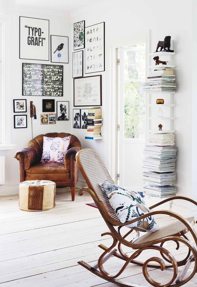"""**Living area** A wall of Lisa's reading corner displays projects she made in school, market finds, pieces from her studio and photos of sons Elliot and Jack. 'Coco tiger' cushion, and 'Safari club' cushion (on rocking chair), [Studio Lisa Bengtsson](https://www.studiolisabengtsson.se/en