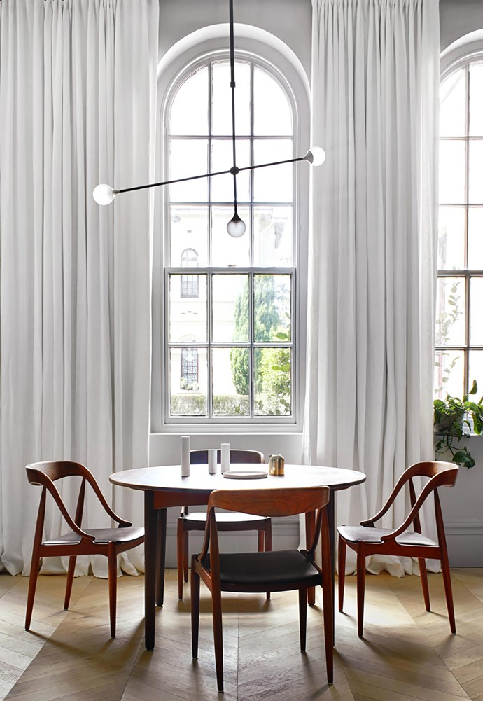 Johannes Andersen dining table and chairs from eBay. 'Bullarum SI-3 Chandelier' by Krisztian Mecs from Intueri Light. 'Freado' chevron flooring from Tongue n Groove.