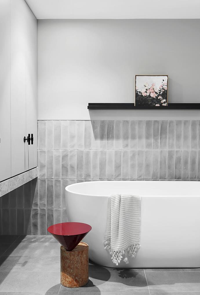 Bathroom tiles from Signorino. Artwork by Emma Persson, Buster + Punch T-bar pulls from Living Edge and De La Espada 'Laurel' side table from Luke Furniture.