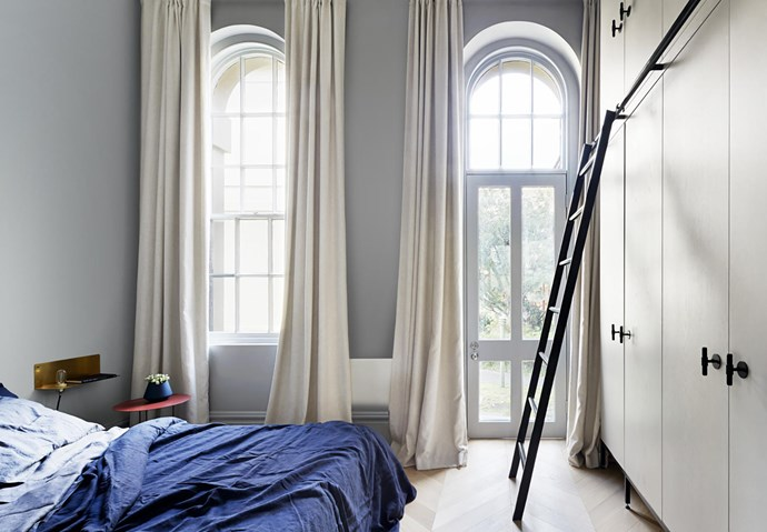 Wardrobes by Guy Phelan with Buster + Punch pulls from Living Edge and a custom ladder. Frama '90°' wall light from Finnish Design Shop, Molteni&C 'Panna Cotta' side table from Hub and bedlinen from In Bed.