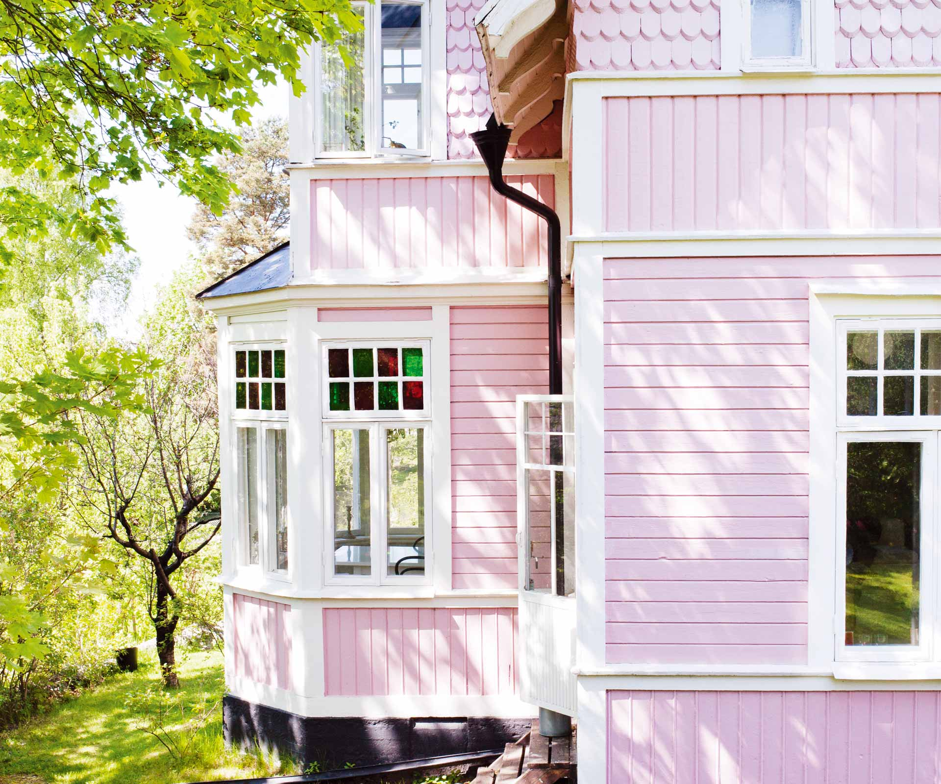 This pink house exterior hides a colourful interior