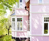 This pink house in Sweden hides a bold and colourful interior