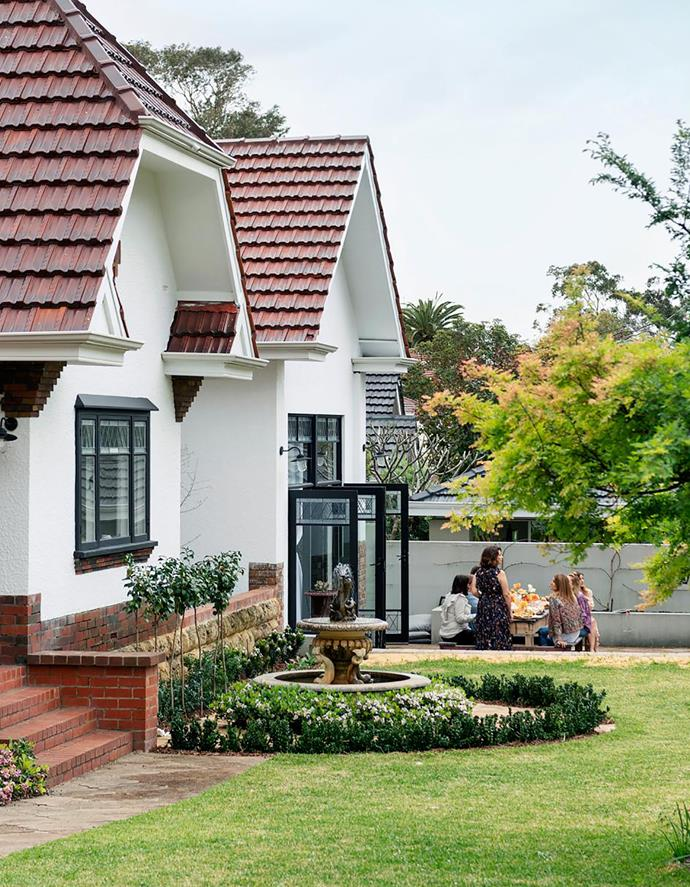 """At a social event with other small-business owners, Debra, a keen baker, lays on a lavish morning tea. The deep front garden is her favourite spot for entertaining. """"It's like being in the country,"""" she says."""