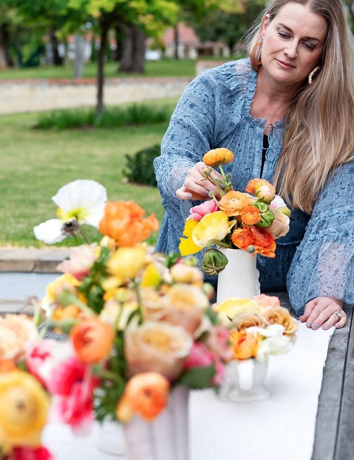 For the table, Debra arranges poppies, ranunculus and anemones in vintage vases. For similar table runner, try David Jones.