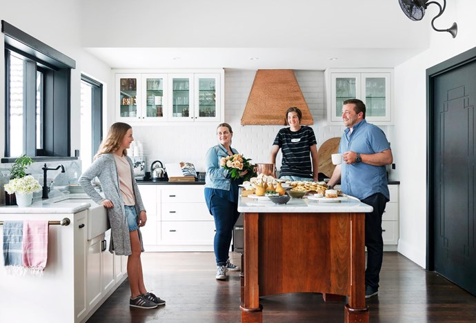 Debra and Tristan join children Stella and Connor. A good example of the home's old-meets-new aesthetic is the modern extractor, fitted inside the existing copper rangehood. Carrara marble benchtops.