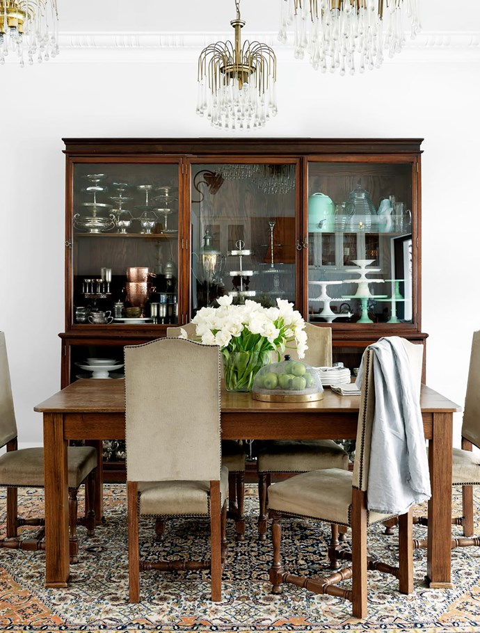 A glass-fronted antique cabinet holds Debra's collection of cake stands. The table and rug are family pieces. Chairs, Scurr's. Pendant lights from Gumtree. Tablecloth, Trilogy. Wire cloche, Williams-Sonoma.