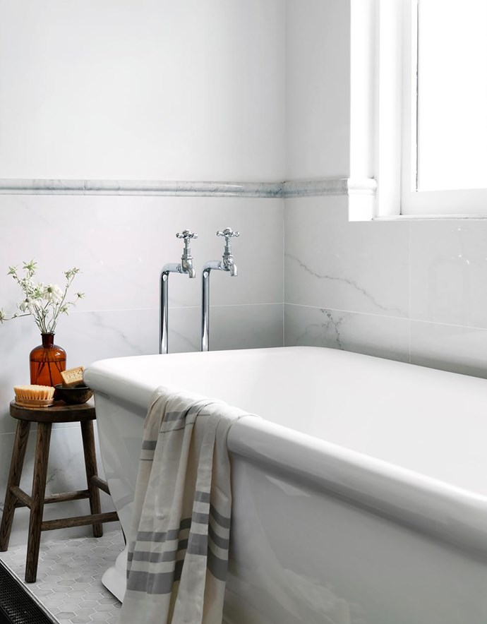 A roll-top bath from Schots Home Emporium evokes an air of luxury. Taps, Sea of White.