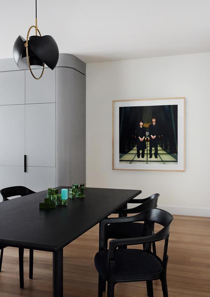 In the dining area, Gubi 'Multi Lite' pendant from Surrounding, 'Steelwood' dining chairs from District, and Selina Ou artwork from Sophie Gannon Gallery.