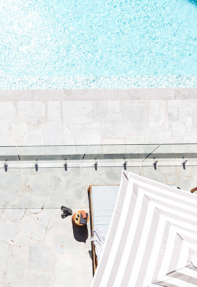 A bird's-eye view of the infinity pool, which has a pool bar.