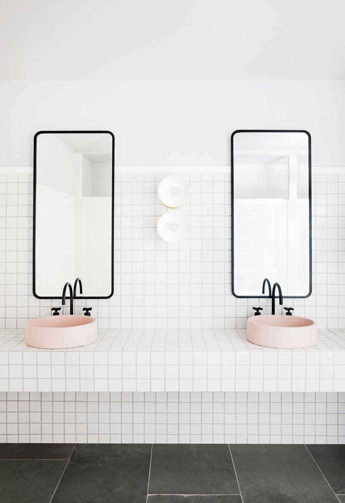 "[Pale pink basins introduce a feminine touch to the bathroom](https://www.homestolove.com.au/millennial-pink-bathrooms-18963|target=""_blank"") of the restaurant."