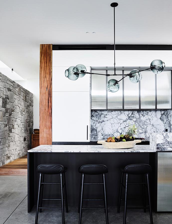 Durable and visually pleasing, these marble benchtops and splashbacks prove the perfect choice for an entertainer's kitchen. *Image: Anson Smart / bauersyndication.com.au*