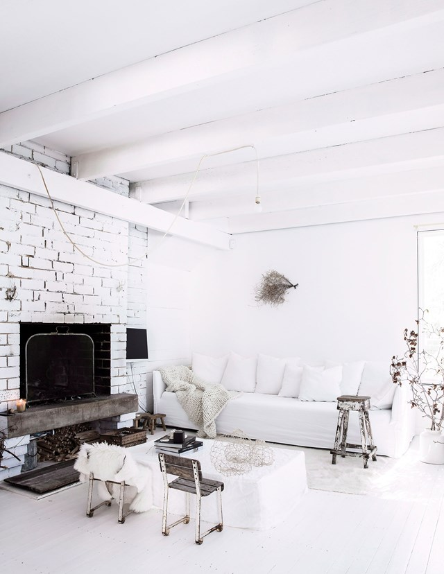 An all-white interior allows rustic furniture and textured timber to take centre stage in this living room. *Photo:* Maree Homer / *bauersyndication.com.au*