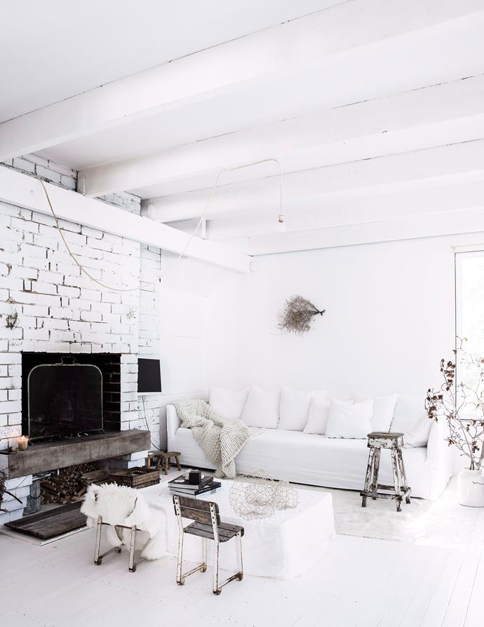 "An [all-white interior](https://www.homestolove.com.au/how-master-an-all-white-interior-5995|target=""_blank"") allows rustic furniture and textured timber to take centre stage in this living room. *Photo: Maree Homer / bauersyndication.com.au*"