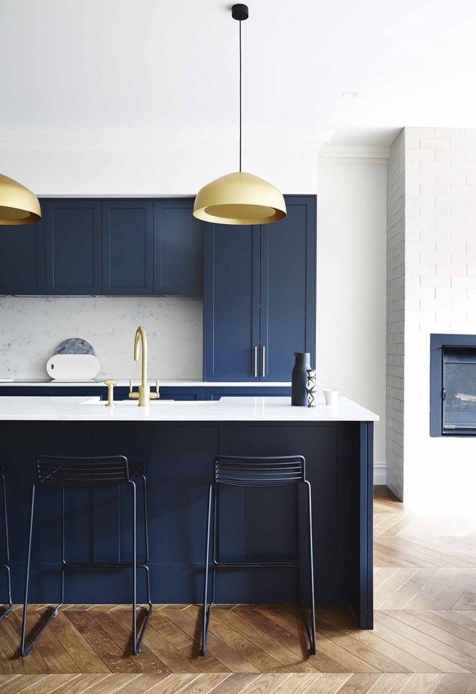"**Something blue** Blue is a bold and contemporary look in this renovated [Edwardian home](https://www.homestolove.com.au/modern-edwardian-semi-renovation-18524|target=""_blank"") with the shaker style cabinet fronts softening up the vibrant look. Elegant Ross Gardam pendant lights make a dramatic statement against the navy and is paired with a gold tap and mixer. *Design: [Sarah Harris Design](http://sarahharrisdesign.com.au/