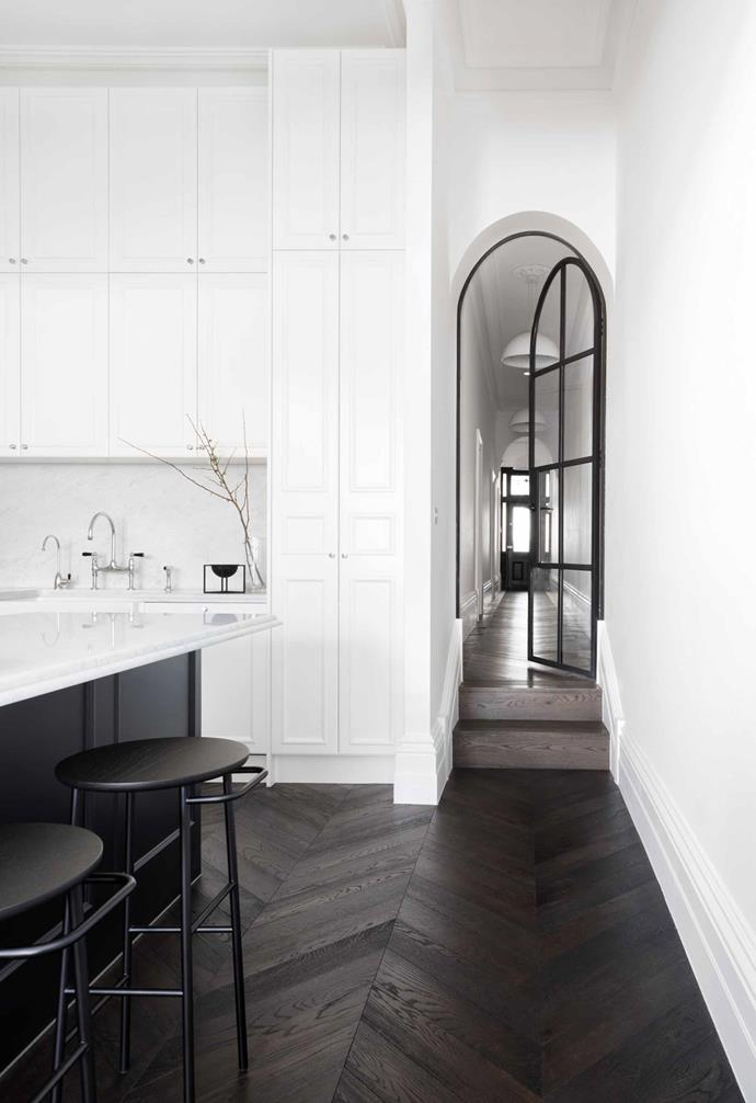 "**Monochrome bliss** This [renovated Melbourne terrace](https://www.homestolove.com.au/this-renovated-melbourne-terrace-features-a-striking-monochrome-palette-16998|target=""_blank"") features a dramatic monochrome palette which continues all the way into the kitchen. Parquetry flooring adds depth to the space, and shaker-style cabinetry softens the kitchen with traditional appeal. *Design: [Biasol](http://biasol.com.au/