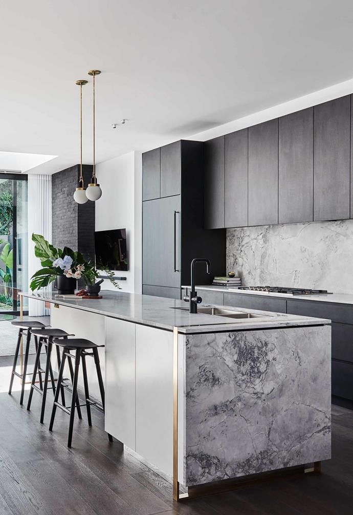 "**All in the details** In *The Block's* Alisa and Lysandra's [renovation of a heritage home in Albert Park](https://www.homestolove.com.au/the-block-alisa-lysandra-albert-park-renovation-19416|target=""_blank"") the kitchen makes a strong visual statement. Dark cabinetry is paired with a moody marble splashback and benchtop, and brass highlights on the island complements the brass pendant lights above the island. *Design: [Alisa and Lysandra](https://www.alisaandlysandra.com.au/